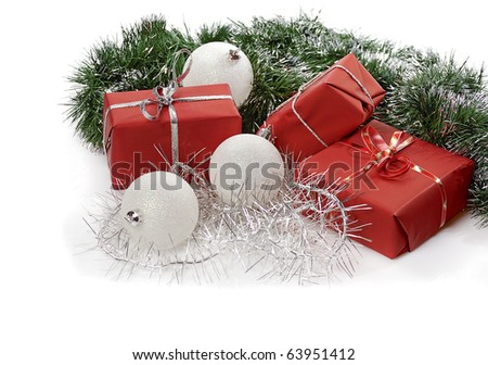 red Christmas gifts with white balls and tinsel  isolated on white background - stock photo