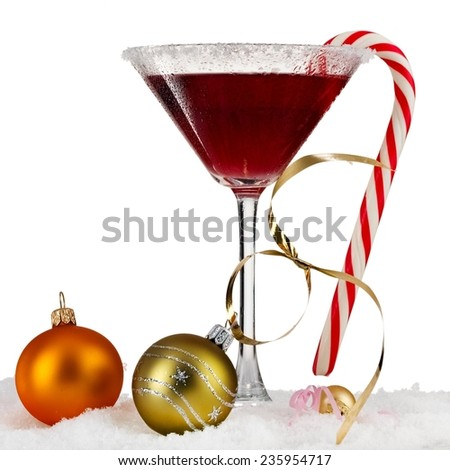 Red christmas martini with lollipop - stock photo