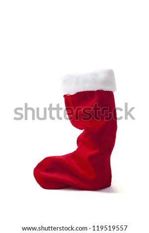 red Christmas stocking standing on white background - stock photo