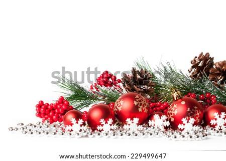 red christmas tree and balls on white. studio shot - stock photo