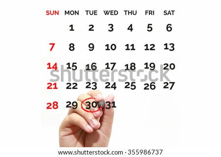 Red circle. Businessman mark on the calendar at 30 - stock photo
