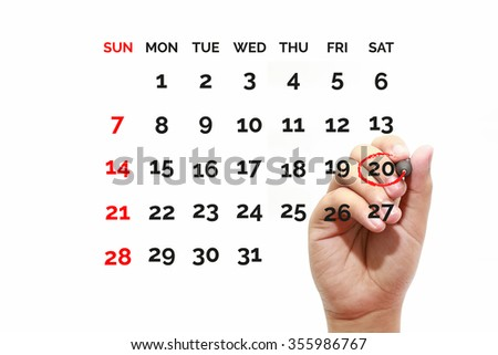 Red circle. Businessman mark on the calendar at 20 - stock photo