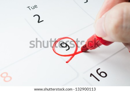 Red circle. Mark on the calendar at 9. - stock photo
