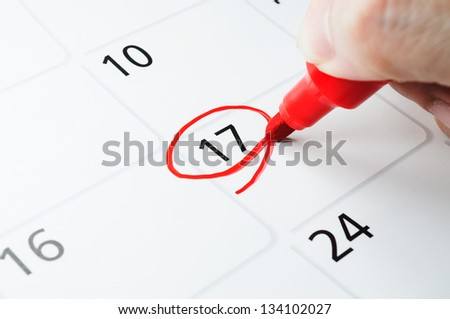 Red circle. Mark on the calendar at 17. - stock photo