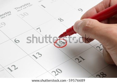 Red circle marked on a calendar concept for an important day - stock photo