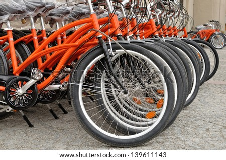 Red city bikes in raw - stock photo