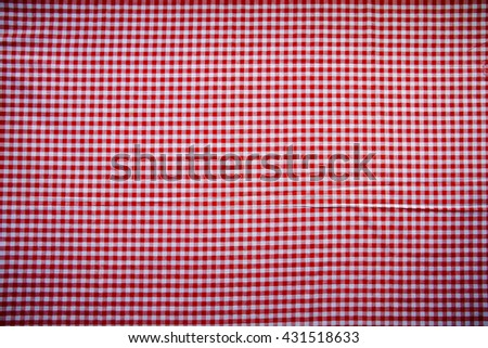 Red classic checkered tablecloth texture, background with copy space - stock photo
