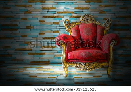 red classical style sofa in dark room - stock photo