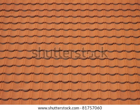 Red clean roof tiles background texture in regular rows. - stock photo