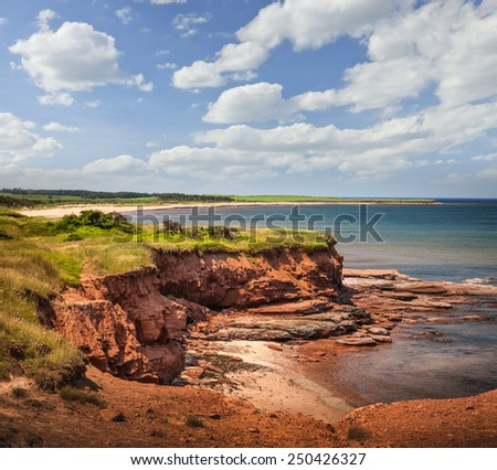 Red cliffs of Prince Edward Island Atlantic coast at East Point, PEI, Canada. - stock photo
