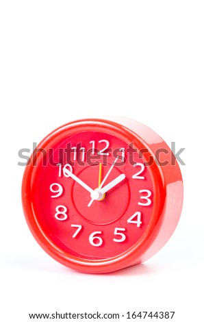 Red clock on isolated white background - stock photo