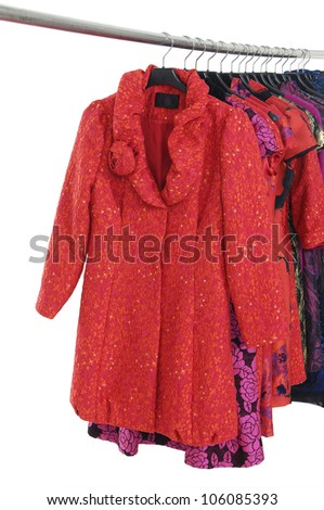 Red clothing on hanger in a row - stock photo