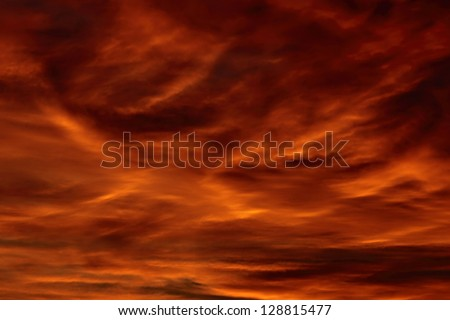 Red, cloudy sky at sunset - stock photo
