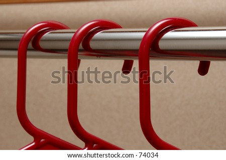 Red Coat Hangers - stock photo