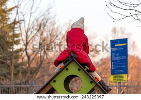 red coat jacket playground kids - stock photo