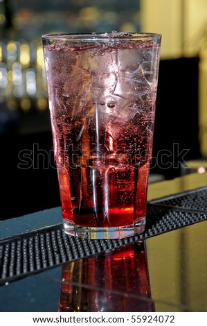 Red cocktail on a bar - stock photo