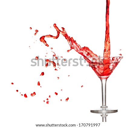 Red cocktail splashing from glass isolated on white background - stock photo