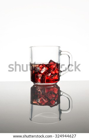 red cocktail with ice cube - stock photo
