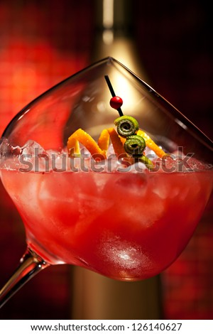 Red Cocktail with Vodka, Orange Juice, Berries and Liquor - stock photo