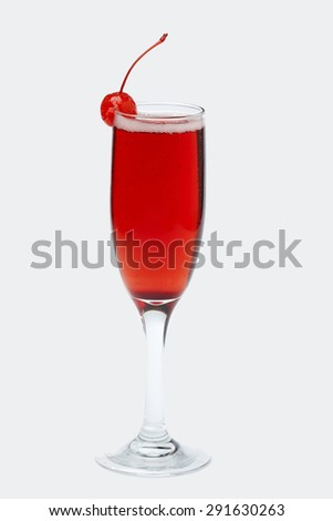 Red coctail with cherry. Isolated on white. - stock photo