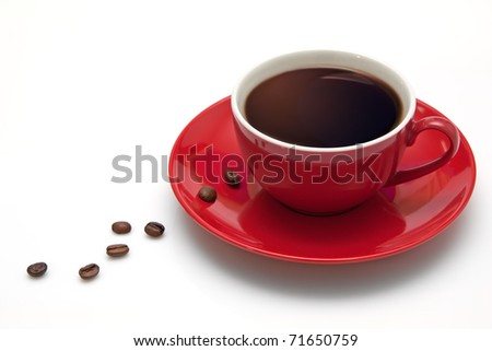 Red coffee cup and grain. - stock photo