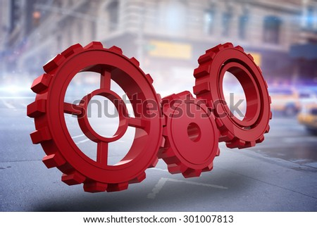 Red cog and wheel against blurred new york street - stock photo