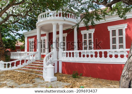 Red colonial style house in Willemstad, Curacao. - stock photo