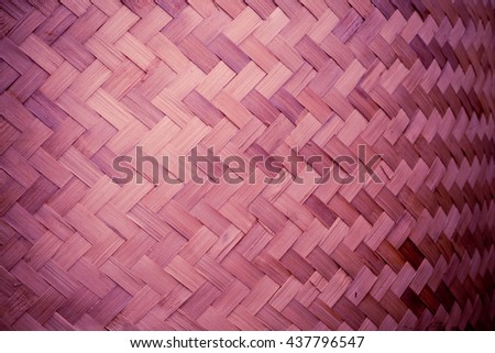 Red color Bamboo grass woven flat mat from natural bamboo background - stock photo