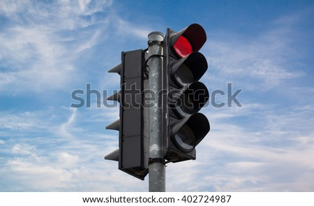Red color on the traffic light on blue sky - stock photo