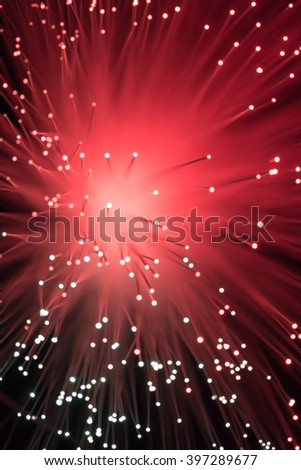 Red colored Bokeh from defocused lights from a fiber optic lamp - stock photo