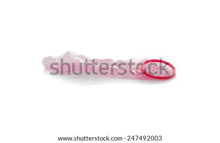 Red condom isolated on white background - stock photo
