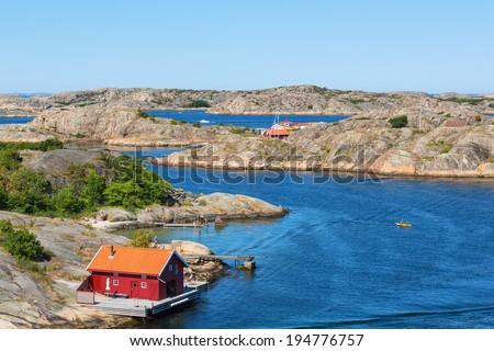 Red cottage by the sea on the Swedish west coast - stock photo