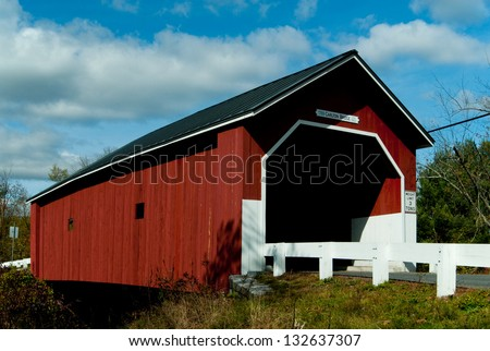 Red covered bridge in New Hampshire. - stock photo