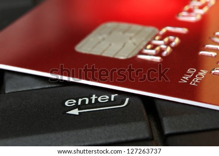 Red Credit Card on a Computer Keyboard - stock photo