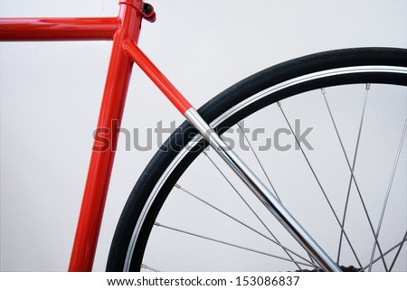 Red cro-mo steel frame, rear wheel, black tire and rim - stock photo