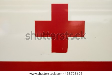 Red Cross - the International Movement of the Red Cross and the Red Crescent, are international humanitarian organizations bringing relief to victims of war or natural disaster. - stock photo