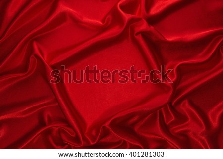 Red crumpled velvet with smooth rectangular plot as background. - stock photo