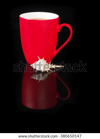Red cup with reflection on black background. - stock photo