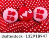red cupcake with I love you  and xoxo written on it - stock photo