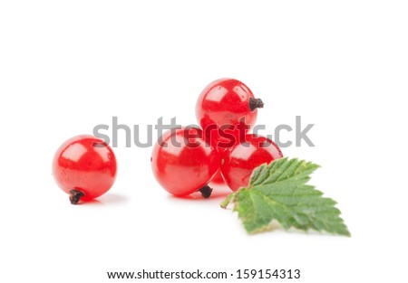 Red currants with green leaf isolated over white background - stock photo