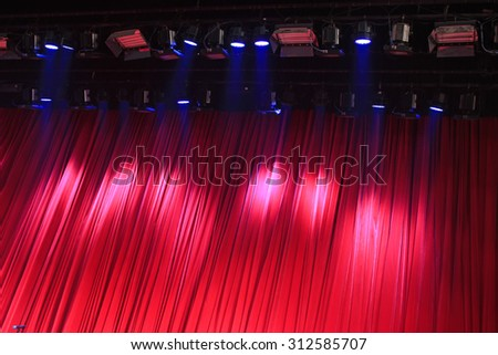 Red curtain and stage lights, closeup of photo - stock photo