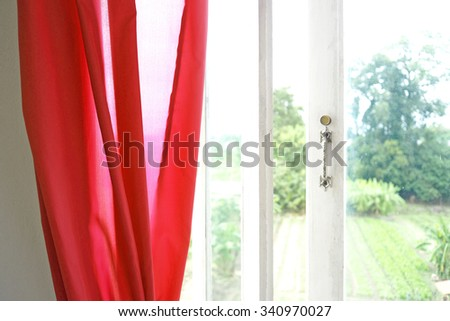 Red curtain and white wooden window. Vintage Interior. - stock photo