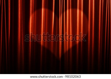 Red curtain background with heart shadow. - stock photo