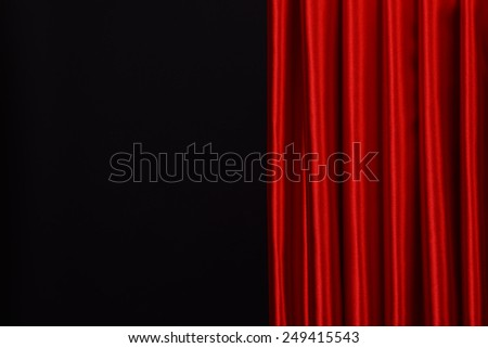Red Curtain on black background - stock photo