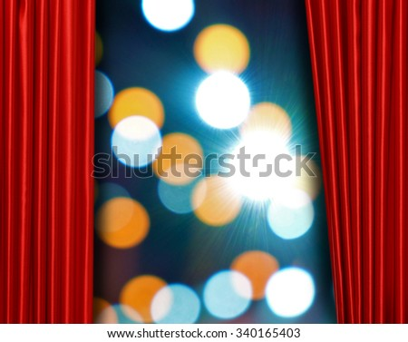 Red curtain on theater or cinema stage slightly open on bright background - stock photo