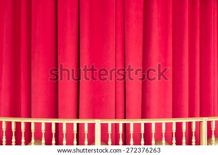 Red Curtain or Drapes with golden yellow railing  - stock photo