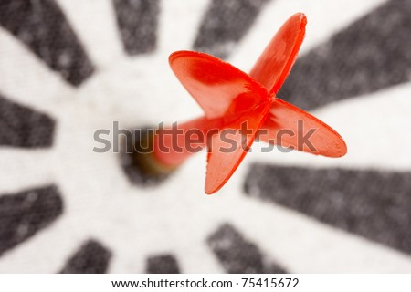 Red dart hitting the center of target - stock photo