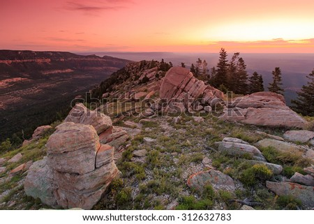 Red dawn sky above the east rim of the Grand Canyon, Arizona, USA. - stock photo