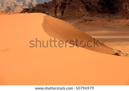 Red desert sand dune in Wadi Rum, Jordan - stock photo