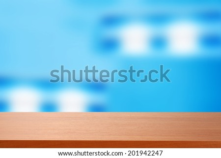 red desk and blue wall  - stock photo
